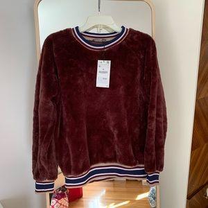Fuzzy sweatshirt top